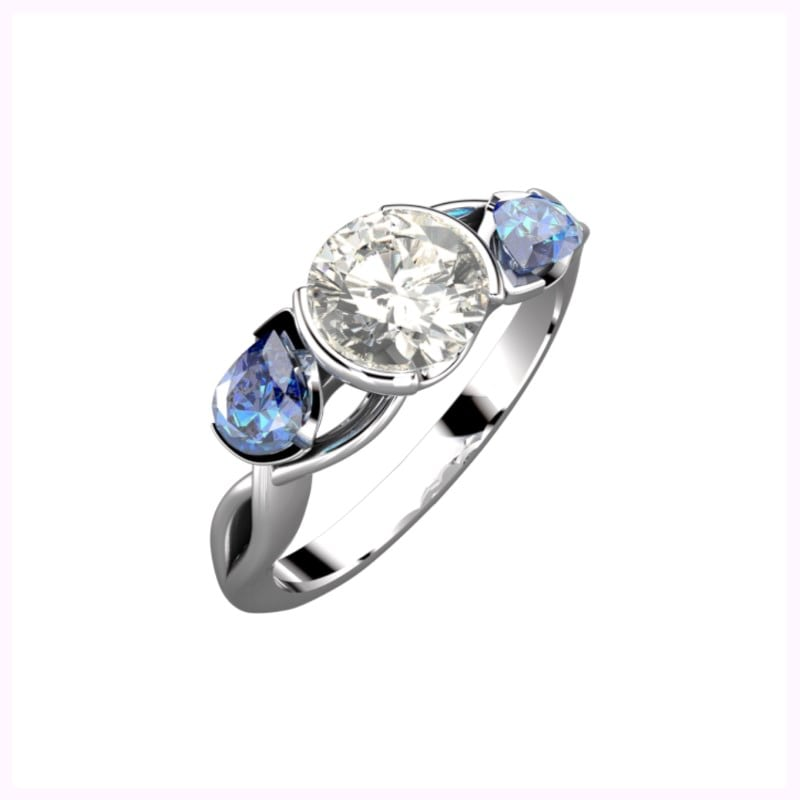 custom made pear shaped sapphire and dia mond three stone ring