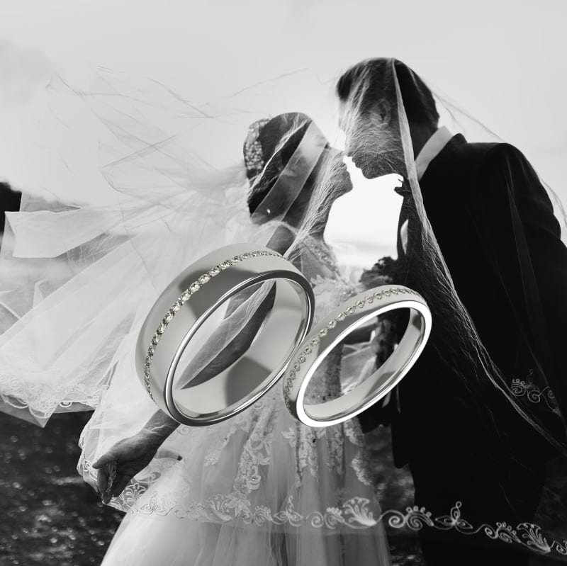 couple on their wedding day with bespoke wedding rings