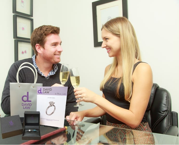 Happy couple celebrating their proposal with a bespoke diamond engagement ring