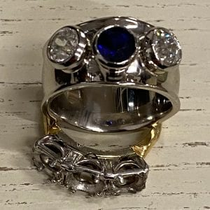 Bespoke platinum sapphire and diamond engagement ring, Remodelled in London by David Law