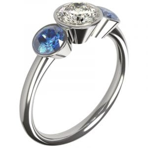 engagement ring designed three stone sapphire and diamond bezel set ring