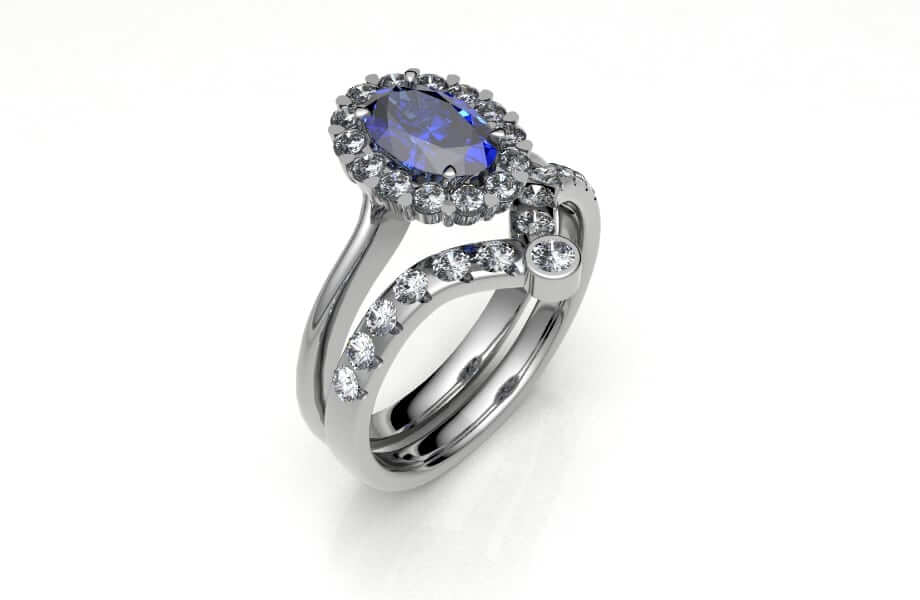 sapphire and diamond cluster engagement ring with fitted diamond wedding ring