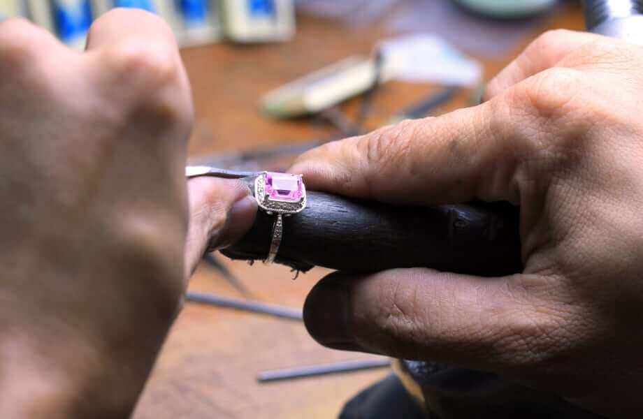 stones being set into a bespoke engagement ring