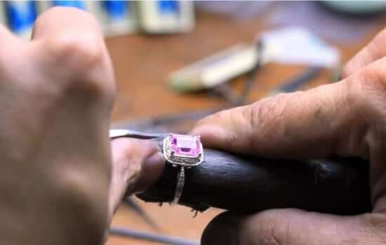 diamond setter setting an engagement ring